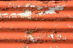 Corrugated metal, with paint flaking off Stock Images
