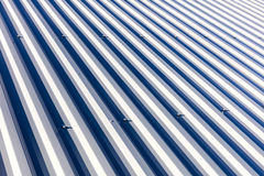 Corrugated metal roof background texture in sunlight Stock Photography