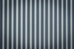 Corrugated metal sheet. Bluish background pattern. Closeup stainless steel corrugated sheet. Ridged reinforced metal surface for protection. Metallic background Royalty Free Stock Photography