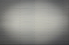 Corrugated metal sheet. Silver gray background pattern with nice vignetting. Royalty Free Stock Photo