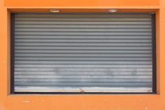 Corrugated metal sheet window. Installed at small shop stock photography