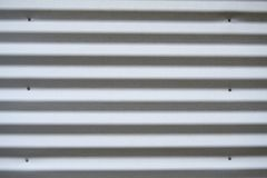 Corrugated metal siding. On a trailer or shed royalty free stock images