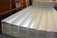 Corrugated metal siding fence. In warehouse Stock Photo