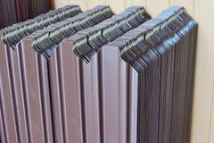 Corrugated metal siding. Painted fence Stock Photo