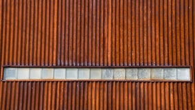 Corrugated Metal Wall with Row of Glass Blocks Royalty Free Stock Photo