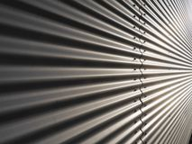 Corrugated metal wall. Corrugated metal warehouse facade abstract Stock Image
