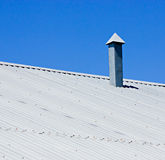 Corrugated metallic gray roof with pipe Royalty Free Stock Photos