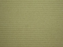 Corrugated paper background. Brown corrugated paper background seeing a detail and color and line on the paper Royalty Free Stock Photo