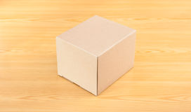 Corrugated paper box on wood table Stock Image