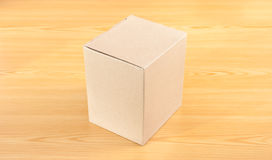 Corrugated paper box on wood table Stock Photography