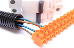 Corrugated pipe, cable with connection block, electric fuse Stock Photos