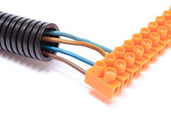 Corrugated pipe and cable with connection block Royalty Free Stock Image