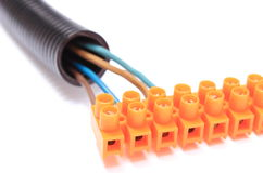 Corrugated pipe and cable with connection block Stock Image