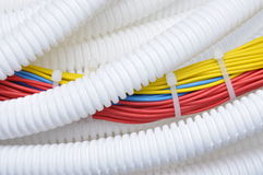 Corrugated pipe with cables Royalty Free Stock Images