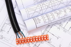 Corrugated pipe and electrical cable with connection cube on drawing Royalty Free Stock Images