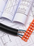 Corrugated pipe and electrical cable with connection cube on drawing Stock Photo