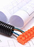 Corrugated pipe and electrical cable with connection cube on drawing Stock Images