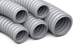 Corrugated pipe for installation of electrical cable. Grey plast Stock Photos