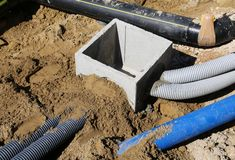 Corrugated pipes for electrical cables and a cockpit in concrete Stock Image