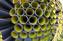 Corrugated pipes in a roadworks for laying optical fiber Stock Images