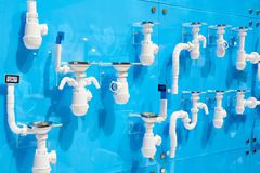Corrugated plastic drain pipes for sinks. In store Stock Images