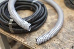 Corrugated plastic hose. Black and grey Royalty Free Stock Photos