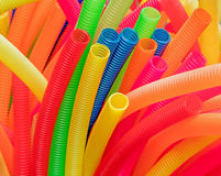Corrugated plastic pipes. Colorful corrugated plastic pipes: red,yellow, blue royalty free stock image
