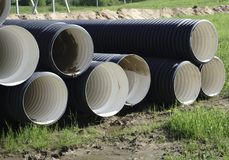 Corrugated plastic pipes at a construction site royalty free stock photography