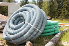 Corrugated plastic pipes used for underground electrical lines.  Stock Photography
