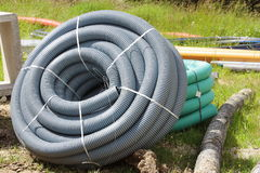 Corrugated plastic pipes used for underground electrical lines.  Stock Images