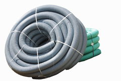 Corrugated plastic pipes used for underground electrical lines (isolated) Royalty Free Stock Photos