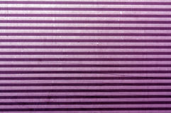 Corrugated purple metal plate surface. Royalty Free Stock Photos