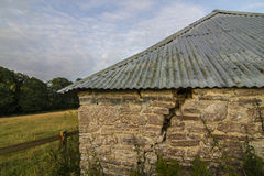 Corrugated roof on old stone building Royalty Free Stock Photos