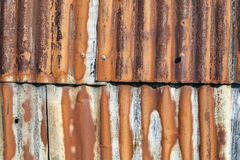 Corrugated rust covered iron fence background Stock Photos