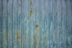 Corrugated rusty metal garage doors texture with lock in center stock image