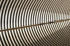 Corrugated semicircular iron gutter border with water Royalty Free Stock Photography