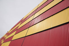 Corrugated siding on building. Abstract view of two-toned corrugated siding on a large building Stock Images