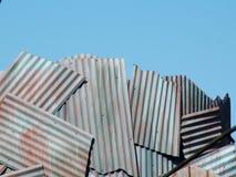Corrugated Sky. Corrugated slab wall against blue sky Stock Photo
