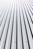 Corrugated steel roof with rivets on industrial building Royalty Free Stock Photography
