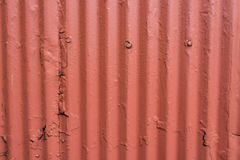 Corrugated Steel Wall with Thick Orange Paint Royalty Free Stock Photos