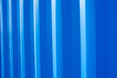 Corrugated storage unit. Surface of corrugated metallic storage unit in shades of blue stock image