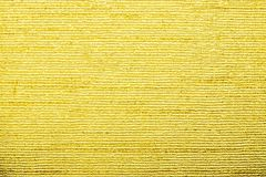 Corrugated texture of golden color with stamping Royalty Free Stock Image