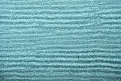 Corrugated texture of indigo color with stamping. Horizontal corrugated texture of paper wallpaper with an imprinted vinyl surface for abstract backgrounds of Royalty Free Stock Photos