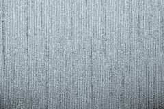 Corrugated texture of silvery color with stamping Stock Photos
