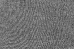 Corrugated textured background of fabric dark gray color Stock Images
