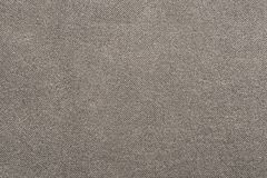 The corrugated textured design of fabric beige color Stock Images