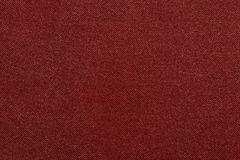 The corrugated textured design of fabric red color Stock Image