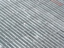 Corrugated tile element of old roof. Royalty Free Stock Images