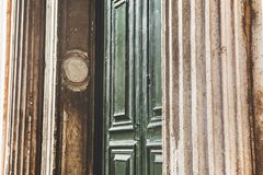 Corrugated wall and wooden door. Architectural details with corrugated wall and ancient door Stock Images