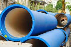 Corrugated water pipes of blue color, large diameter, prepared for laying. Plumbing or sewerage stock image